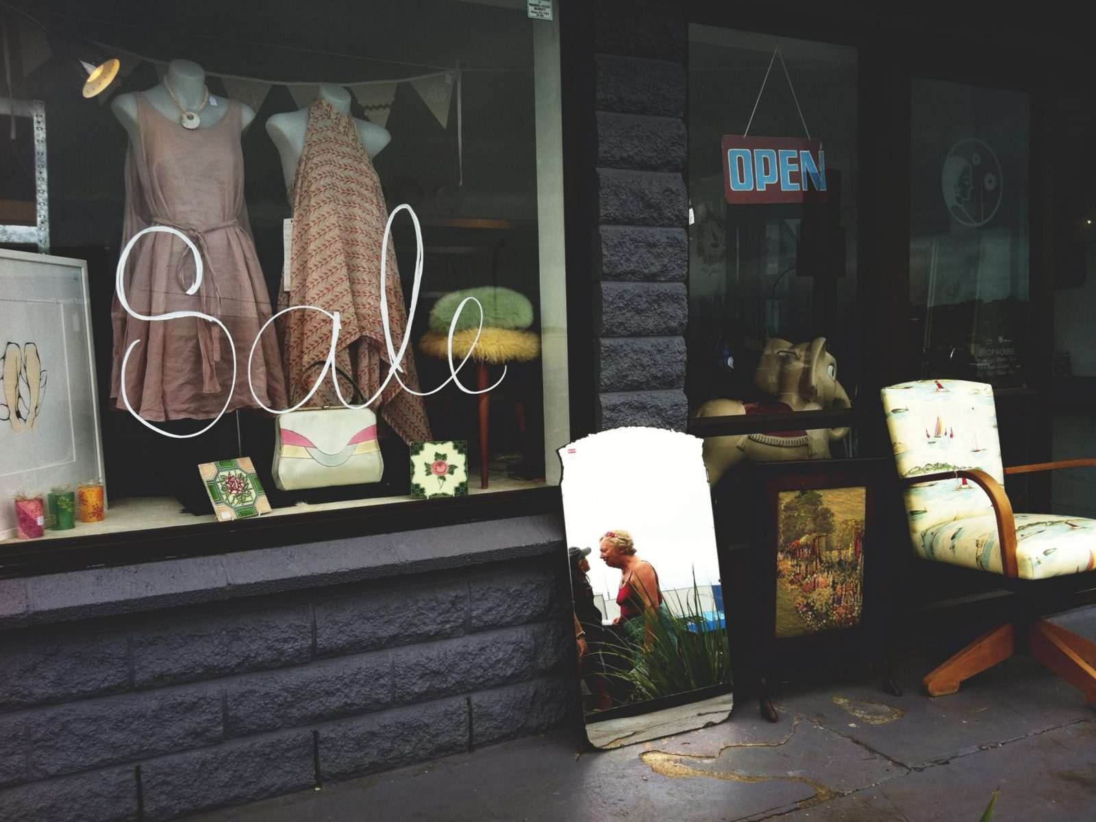 façade of a local business selling women's apparel; currently offering items on sale and looking for the best payment methods for small business