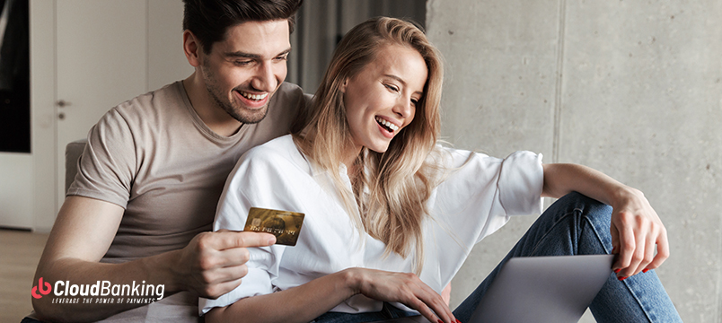 couple using credit card for their online purchase