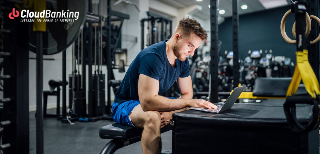 person transacting online while at the gym